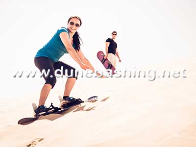 sandboarding in morning Desert Safari Dubai