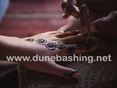 henna design in desert camp